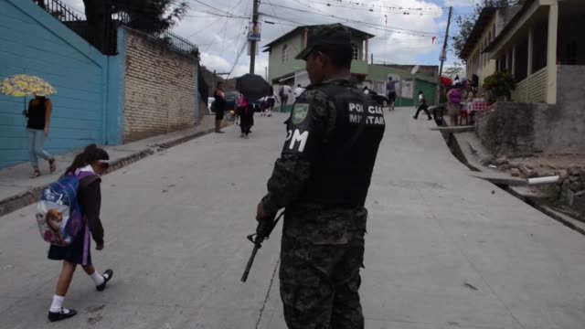 military police set up guard around the maximiliano sagastume school in honduras after a clash between rival gangs wounded four students and a... - occurrence stock videos & royalty-free footage