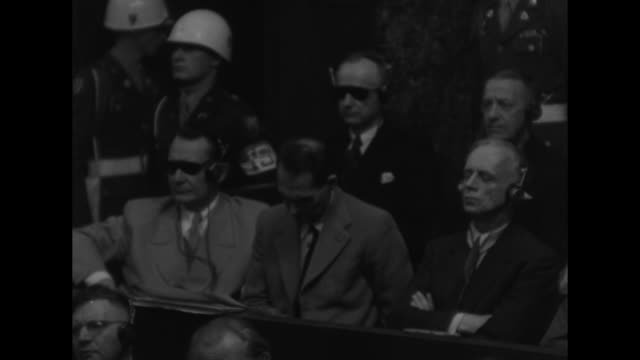 military police stand behind defendants at the nuremberg trials in the dock lr hermann goering rudolf hess joachim von ribbentrop karl doenitz erich... - defendant stock videos & royalty-free footage