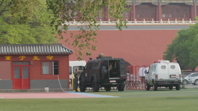 military police stationed behind the tiananmen gate - mp stock videos & royalty-free footage