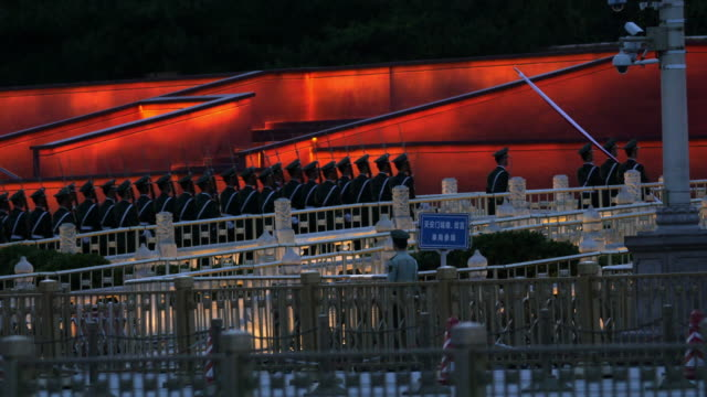 military policemen guarding national flag after sunset ceremony - 前ボケ点の映像素材/bロール