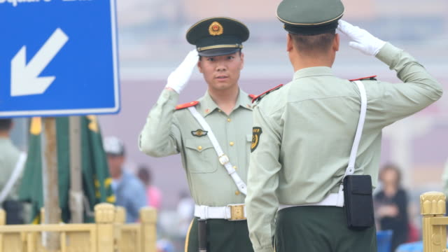 military policemen saluting at the tiananmen square, beijing, hina - tiananmen square stock videos and b-roll footage