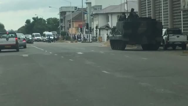 military presence on streets of harare as zimbabweans weigh an uncertain future without president robert mugabe after the army took power and placed... - harare stock videos and b-roll footage