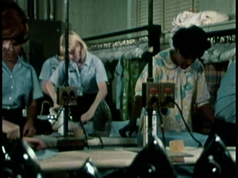 vídeos de stock e filmes b-roll de 1968 montage military recruitment film featuring women ironing and being fitted for their uniforms / united states  - 1968