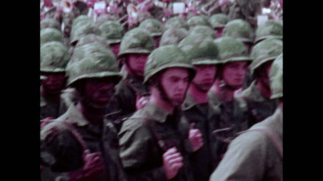 / military recruitment film soldiers in ceremonial parade on parade grounds carrying flags vice president spiro agnew watching - division stock videos & royalty-free footage