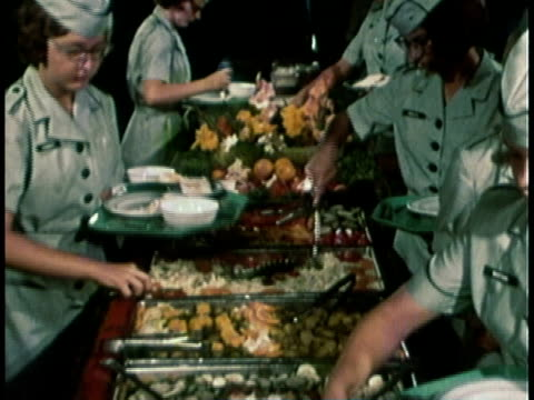 1968 montage military recruitment video showing women dishing up food at buffet and one woman sitting and talking / united states  - military recruit stock videos & royalty-free footage