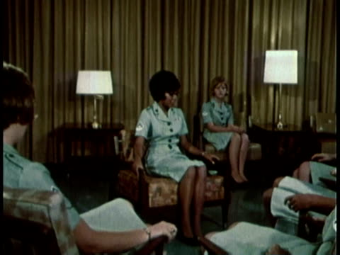 1968 montage military recruitment video showing women learning how to properly sit / united states  - マナー点の映像素材/bロール