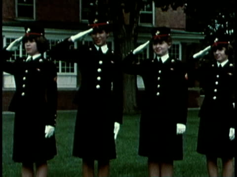 1968 montage military recruitment video showing women standing at attention as military men walk in form with riffles on their shoulder / united states  - military recruit stock videos & royalty-free footage
