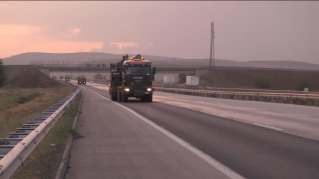 Military semitrailer trucks are seen on the Gaziantep Sanliurfa highway as they carry 15 tanks sent to Suruc district of Sanliurfa to increase the...