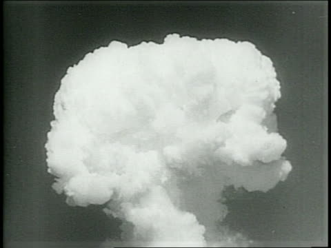 Military Ships Catching Fire / Mushroom Cloud Reaches Into Sky / Close Up Of Mushroom Cloud / Narrated