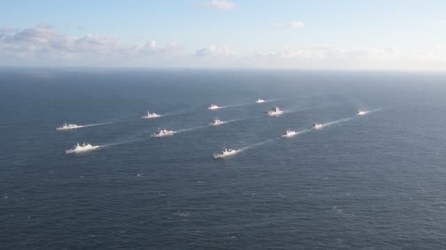 military ships from canada, denmark, france, italy, the netherlands, norway, spain, united kingdom and the united states sail the atlantic ocean in... - 米国海軍点の映像素材/bロール