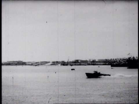 vídeos y material grabado en eventos de stock de military ships in harbor, planes fly overhead. - 1941