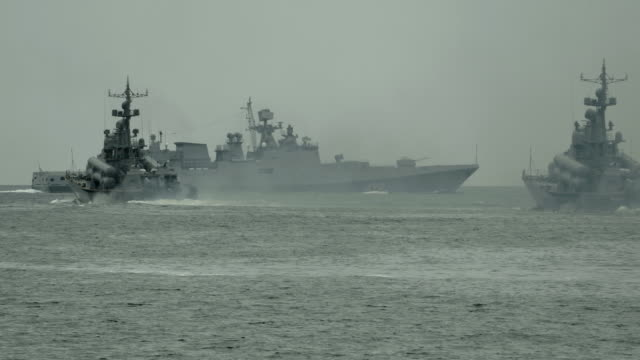 Military ships on military exercises in the sea
