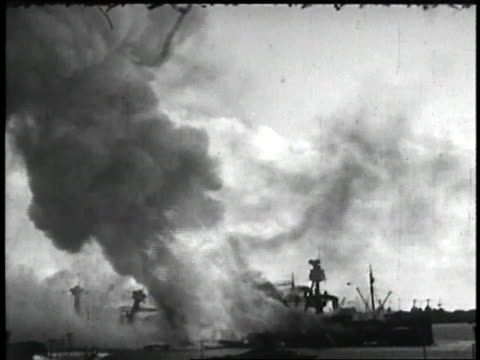 us military ships sink in a billow of smoke and flames as japan attacks pearl harbor - militärschiff stock-videos und b-roll-filmmaterial