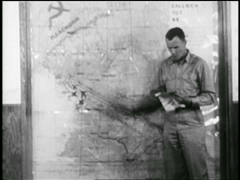 b/w 1951 military soldier pointing to map during korean war / educational - solo una donna matura video stock e b–roll