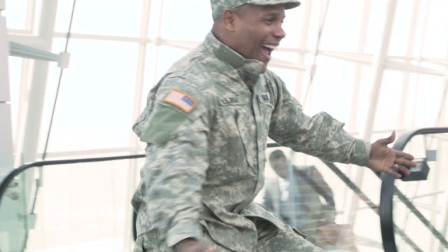 Military soldier returning home greeted by his family