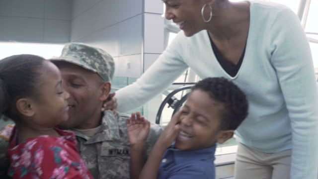military soldier returning home greeted by his family - heroes stock videos & royalty-free footage