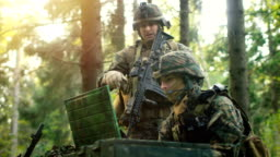Military Staging Base, Commander Gives Orders to Chief Army Engineer Uses Army Grade Laptop Issued by Military Industrial Complex. Soldiers Prepare for Deployment for Reconnaissance Operation/ Mission.