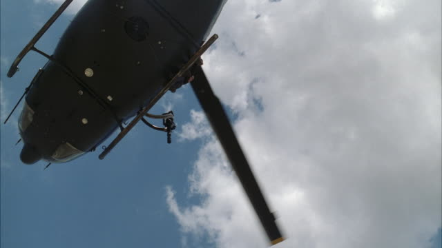 ms military style helicopter - helicopter rotors stock videos and b-roll footage