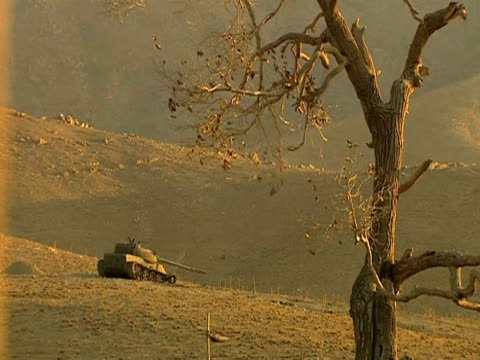 us military tank on patrol afghanistan 28 january 2010 - 2001年~ アフガニスタン紛争点の映像素材/bロール