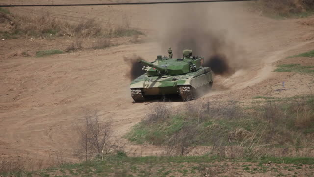 t99 military tank running - armoured vehicle stock videos and b-roll footage