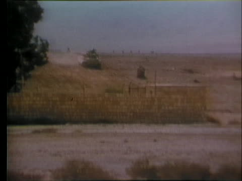 military tanks fire in the sinai, in violation of a cease-fire agreement. - (war or terrorism or election or government or illness or news event or speech or politics or politician or conflict or military or extreme weather or business or economy) and not usa stock videos & royalty-free footage