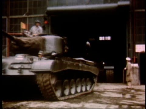 1951 ws military tanks rolling out of garage / detroit, michigan, united states - armoured vehicle stock videos and b-roll footage