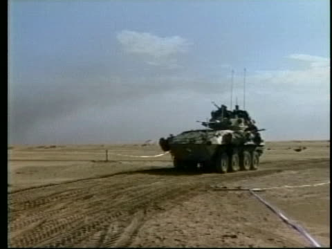 military tanks travel across a desert track in iraq during desert storm. - desert stock videos & royalty-free footage