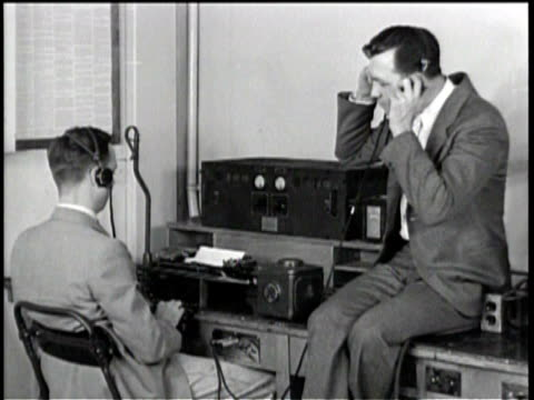 military teletype operators sending and receiving messages / a naval message is typed out / the american flag flies on a ship - headphones stock videos & royalty-free footage