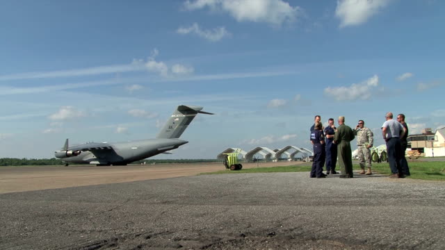 C17 military transport aircraft unloads supplies for gulf relief at the New Orleans Naval Air Station Lt Commander Tony Russel and Commander Chris...