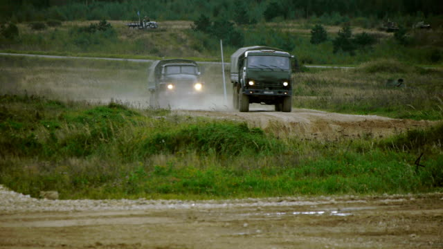 military trucks on a dirt road - armed forces stock videos & royalty-free footage