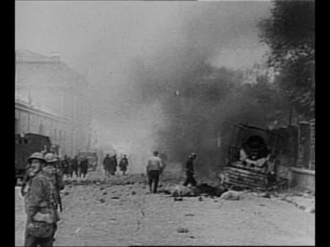 military vehicle burns in france during world war ii with people in background and soldiers headed toward it / vehicle burns / german soldiers ride... - evakuierung von dünkirchen stock-videos und b-roll-filmmaterial