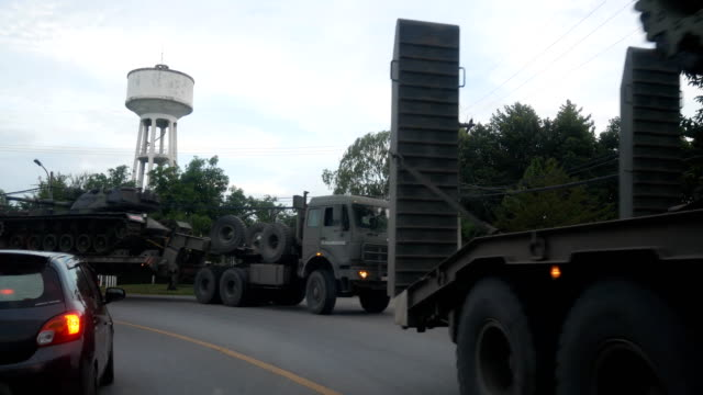 military vehicle moving convoy - armored truck stock videos and b-roll footage