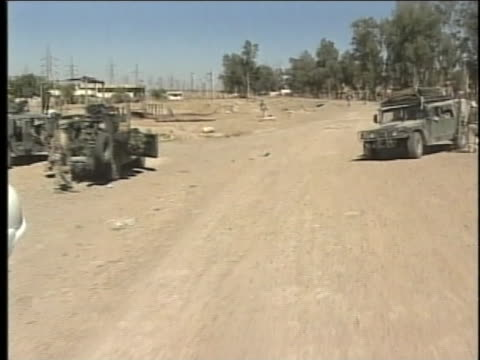 military vehicle pulls away from other vehicles in a convoy. - al fallujah stock videos & royalty-free footage