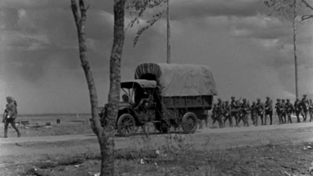 u.s. military vehicles and soldiers move along a dusty road during world war i. - 1927 stock videos & royalty-free footage