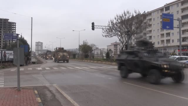 military vehicles belonging to the turkish army on their way to syrian border in turkey's southeastern kilis province on january 02 2019 as part of... - 可能点の映像素材/bロール