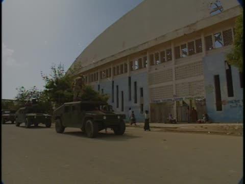 US military vehicles drive away from Mogadishu stadium during Somali conflict of 1993