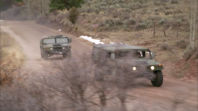 aerial, ts, military vehicles driving on dirt road, usa - military land vehicle stock videos & royalty-free footage