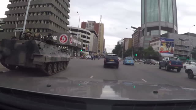 military vehicles in the streets of harare zimbabwe after the military coup to remove president robert mugabe - staatsstreich stock-videos und b-roll-filmmaterial