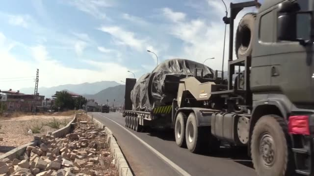 military vehicles including tanks and armoured vehicles are being deployed to syrian border to support the units in hatay turkey on october 10 2019... - hatay stock videos & royalty-free footage