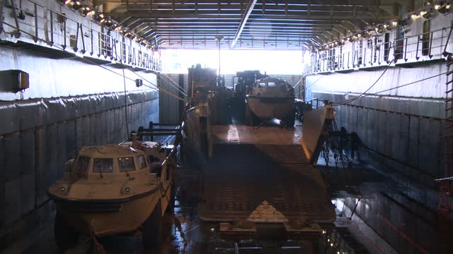 military vehicles on ship deck - amphibious vehicle stock videos & royalty-free footage