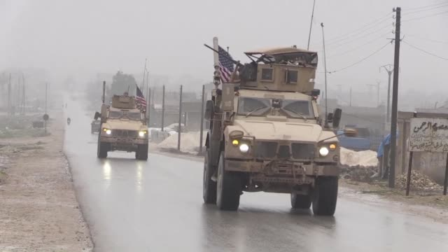us military vehicles patrol in the strategic city of manbij in syria near the turkish border despite president donald trump's shock announcement this... - kurdischer abstammung stock-videos und b-roll-filmmaterial
