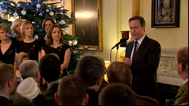 military wives choir perform at downing street and meet pm; england: london: downing street: no.10 int bv david cameron mp talking to members of... - chores stock videos & royalty-free footage