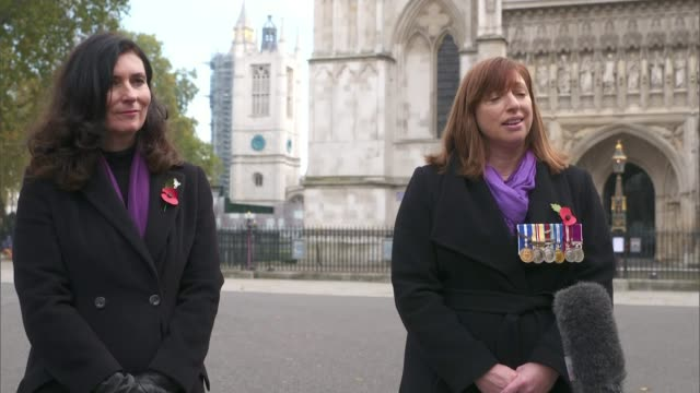 military wives choirs mark the 100th anniversary of the burial of the unknown warrior; england: london: westminster: ext jules interview sot. - tomb of the unknown warrior westminster abbey stock videos & royalty-free footage