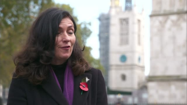 military wives choirs mark the 100th anniversary of the burial of the unknown warrior; england: london: westminster: ext katherine interview sot. - tomb of the unknown warrior westminster abbey stock videos & royalty-free footage
