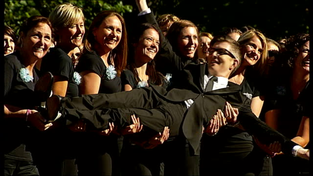 military wives launch second album gareth malone hugging members of choir and along gareth malone interview sot choir members lifting malone for... - アルバムのタイトル点の映像素材/bロール