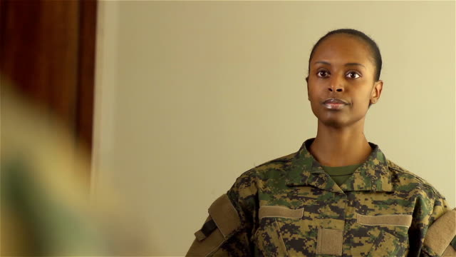 military woman dressing in front of mirror - military uniform stock videos & royalty-free footage
