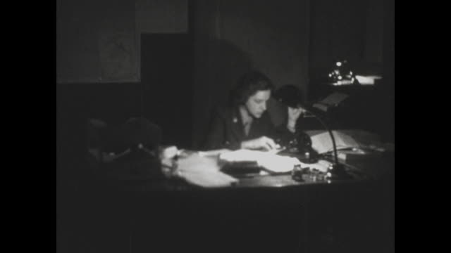 military woman eats a sandwich and works at her desk during the korean war. - only women stock videos & royalty-free footage