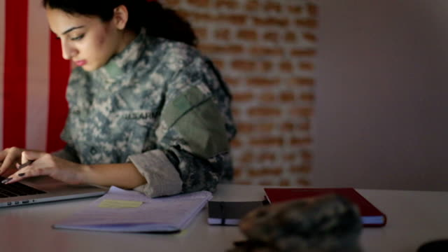 Military woman working on laptop