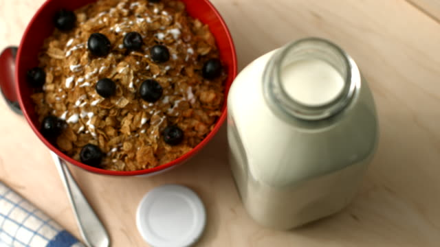 milk and blueberry cereal - milk bottle stock videos & royalty-free footage