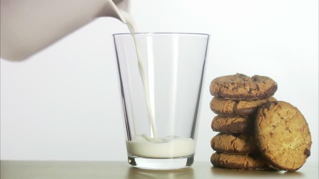 milk and cookies. - biscuit stock videos & royalty-free footage
